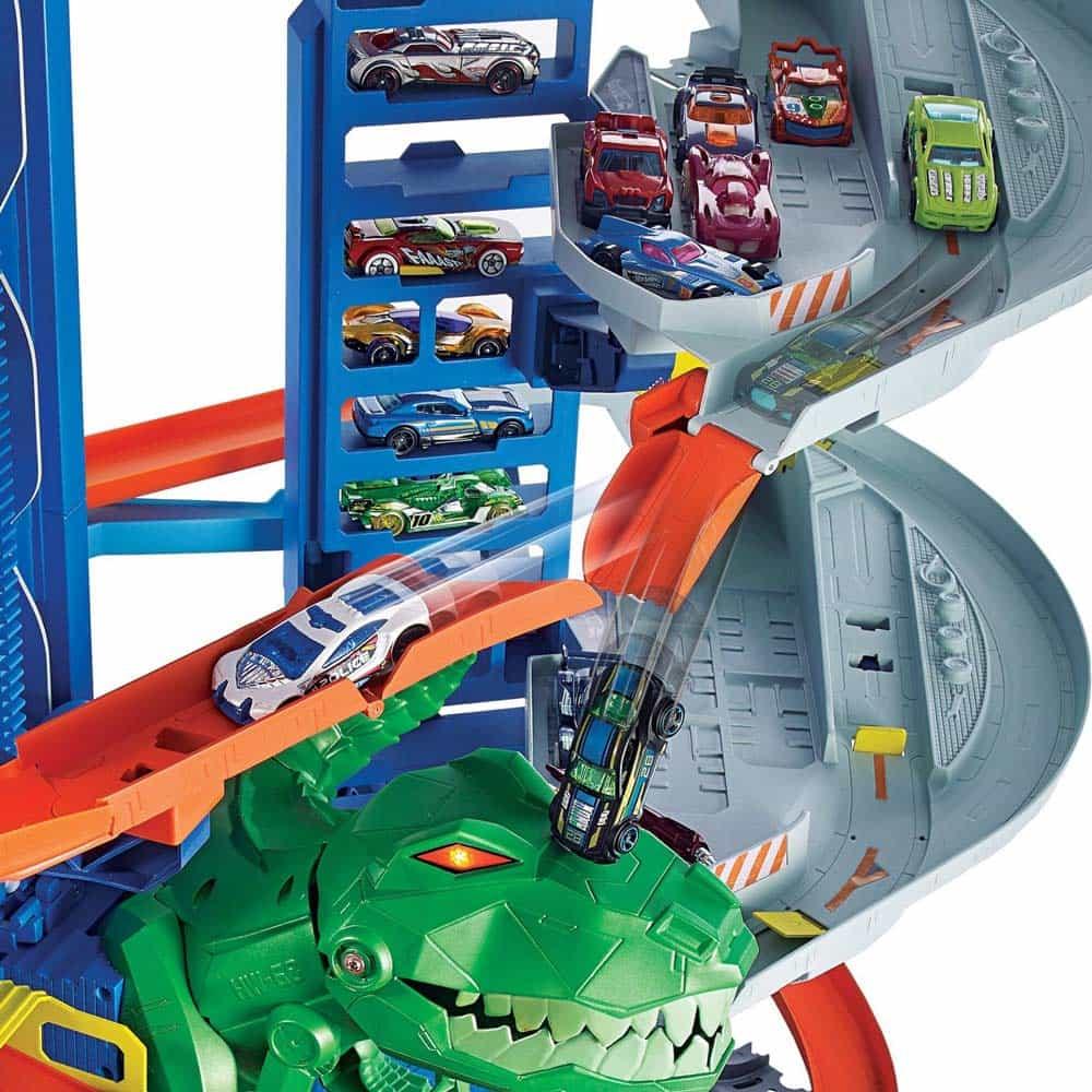 Hot Wheels Set de joacă T-Rex Ultimate garaj cu două mașinuțe GJL14